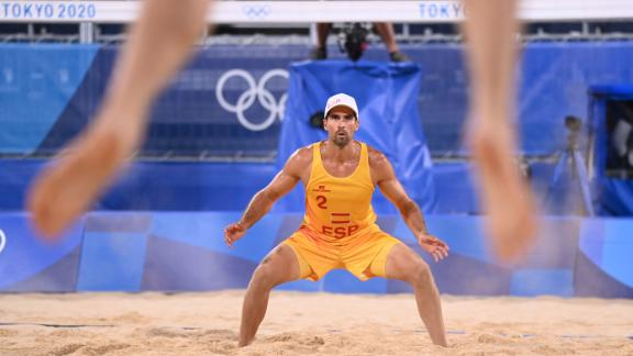 Spain's Adrian Gavira Collado waits for a serve during a beach volleyball match on July 26.