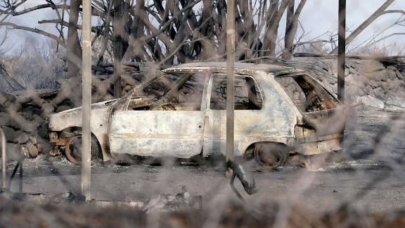 A burned car in Sardinia. The island's government declared an emergency over the weekend.