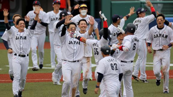 Japan's baseball players celebrate a 4-3 walk-off victory over the Dominican Republic on July 28. It was the first baseball game of these Olympics.