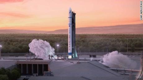 """An artist's rendition of Isar Aerospace's first generation """"Spectrum"""" rocket taking off from an imaginary launch pad."""
