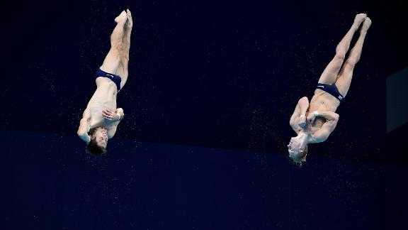 American divers Michael Hixon, left, and Andrew Capobianco compete in the synchronized 3-meter springboard event on July 28. They won silver. China's Wang Zongyuan and Xie Siyi won gold.