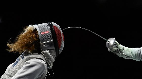 Canadian fencer Eleanor Harvey, left, competes against France's Ysaora Thibus in a foil team quarterfinal on July 29.