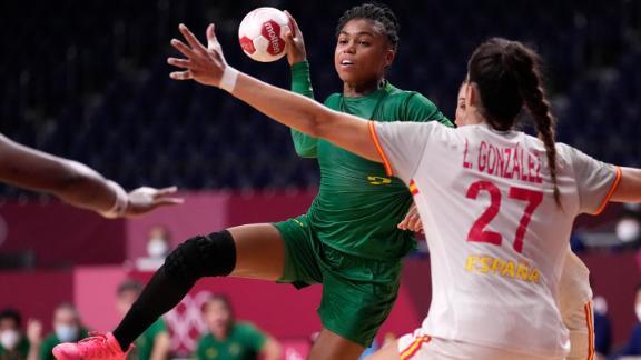 Brazil's Bruna de Paula is defended by  Spain's Lara González Ortega during a preliminary round handball match on July 29.