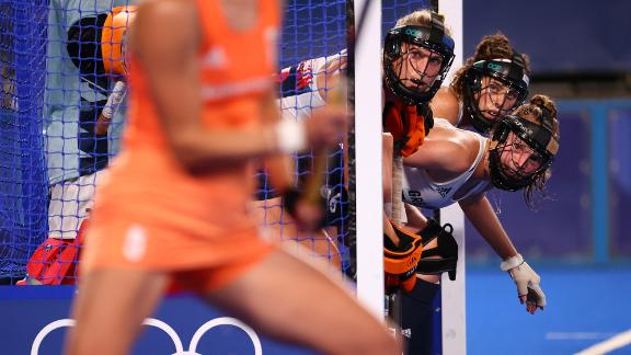 British field hockey players prepare to defend a penalty corner during a match against the Netherlands on July 29.