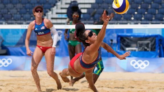 US beach volleyball player Sarah Sponcil stretches out for a ball during a match on July 29.