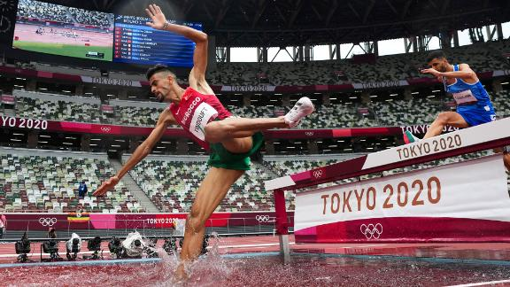 Morocco's Mohamed Tindouft falls while competing in the 3,000-meter steeplechase on July 30.