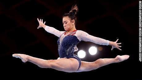 Lee competes on balance beam during the women's all-around final.