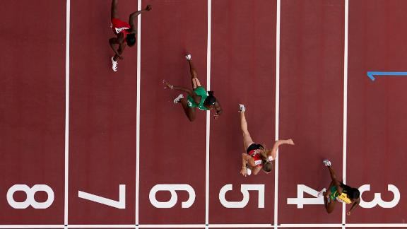 From left, Gambia's Gina Bass, Nigeria's Nzubechi Grace Nwokocha, Switzerland's Ajla Del Ponte and Jamaica's Shelly-Ann Fraser-Pryce compete in a preliminary heat for the 100-meter dash on July 30. Fraser-Pryce, who won the event at the 2008 and 2012 Olympics, finished in first.