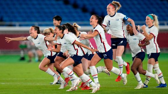 US players celebrate after they defeated the Netherlands in a penalty shootout July 30 to advance to the semifinals in women's football.