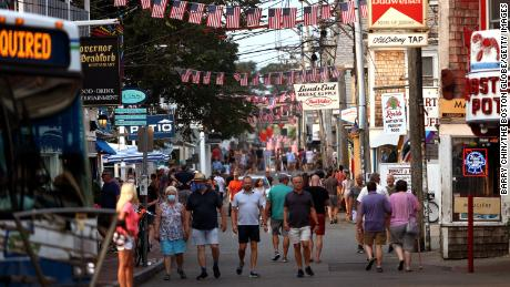 People walk down Commercial Street in Provincetown on Tuesday, July 20.