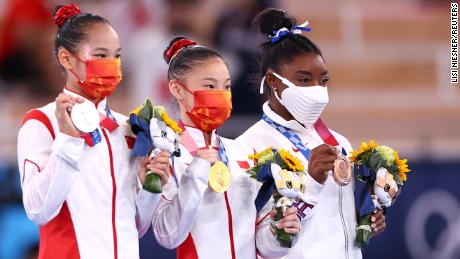Guan Chenchen wins balance beam gold at the Tokyo Olympics as Simone Biles claims bronze