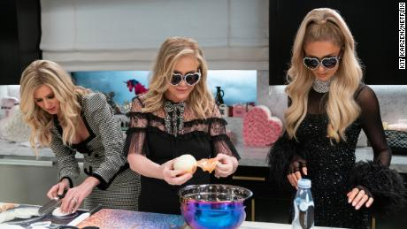 """The Hilton family cutting onions in """"Cooking with Paris."""""""