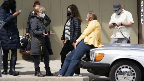 """A photo from the set of """"Physical."""" Annie Weisman (left) and Stephanie Laing (center) are pictured with actor Rory Scovel."""