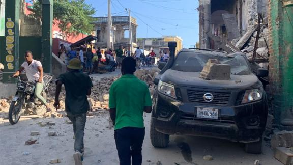 Buildings and cars were damaged in Les Cayes, Haiti.