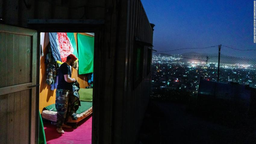 """An Afghan soldier, who didn't want to use his name, is seen at an outpost in Kabul on August 15. He looked at the city below and said, """"This is like a quick death,"""" referring to the fall of Kabul. He said it was going to be a hard moment for him when he removes his uniform permanently after 10 years of service."""