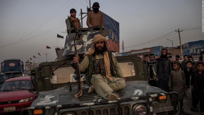 Taliban fighters ride a Humvee near a Kabul roundabout on August 15.