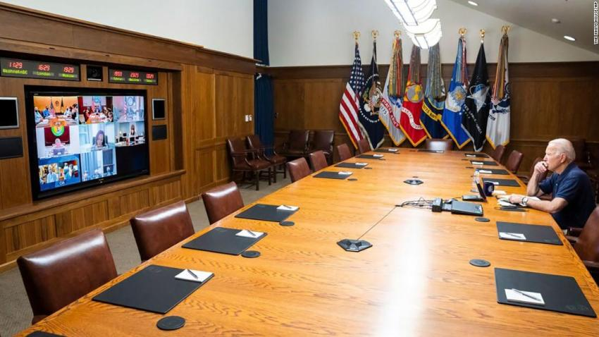 US President Joe Biden holds a virtual meeting with senior officials and members of his national security team on August 15. Biden was working from Maryland's Camp David, the presidential retreat where he was vacationing at the time.