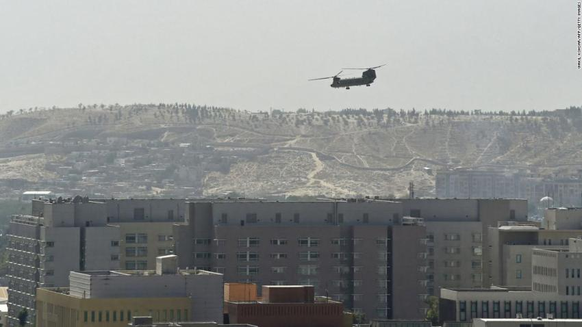 A US military helicopter flies above the US Embassy in Kabul on August 15. The embassy was evacuated as Taliban fighters entered the city.