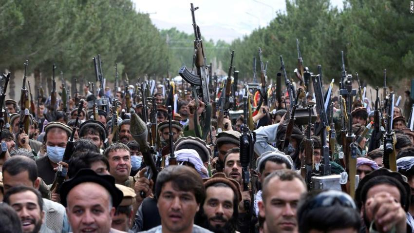 Hundreds of armed men attend a gathering on the outskirts of Kabul on June 23 to announce their support for Afghan security forces and say that they are ready to fight against the Taliban.