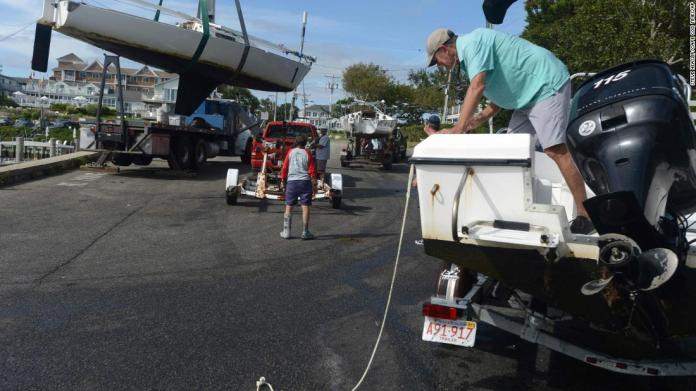 Sailboats are hauled onto trailers in Hyannis, Massachusetts, on Friday, August 20.