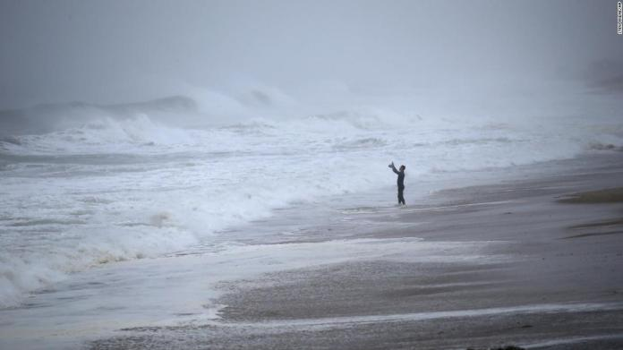 Matt Prue takes photos of waves in Westerly, Rhode Island, on August 22. The storm made landfall near Westerly.