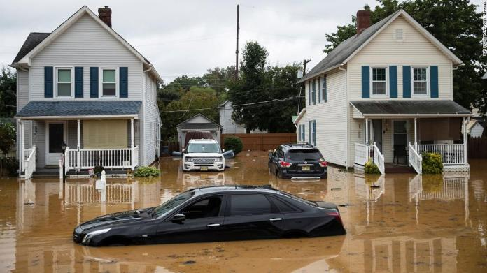 Cars are submerged on a residential street following a flash flood in Helmetta, New Jersey.
