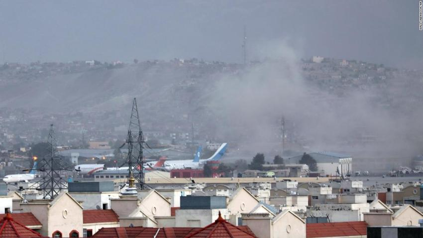 Smoke rises from the explosion outside the airport in Kabul on August 26.