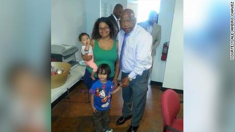 Alejandro Chavez's wife, Natacha, and children, Alejandro and Amelia, meet John Lewis in 2014.