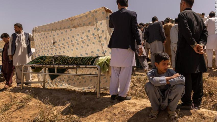 """Ruhullah, 16, mourns during <a href=""""https://www.nytimes.com/2021/08/27/world/asia/afghanistan-airport-bombing-family.html"""" target=""""_blank"""">the burial of his father,</a> Hussein, a former police officer who was killed in the attack at the Kabul airport. Ruhullah survived the blast but got separated from his father and did not know he had died until he made his way back to his family a day later."""