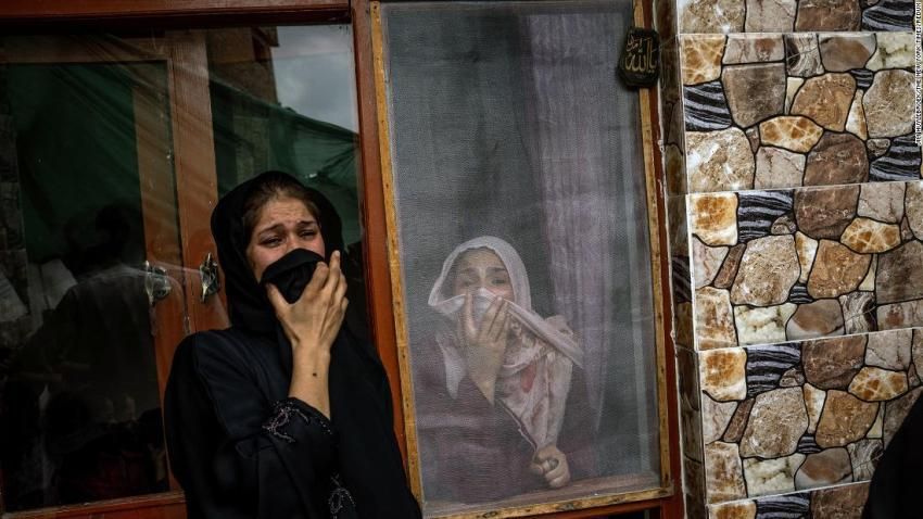 Samia Ahmadi, right, whose father and fiancé were both dead following the US drone strike, mourns her loved ones on August 30.