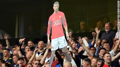 Manchester United fans hold up a cardboard cut out of Cristiano Ronaldo during their Premier League match at Wolves.