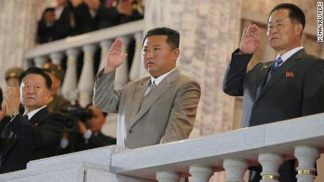 North Korea leader Kim Jong Un (center) attends a parade held to mark the 73rd anniversary of the republic in Pyongyang. This undated image was supplied by North Korea's Korean Central News Agency on September 9.