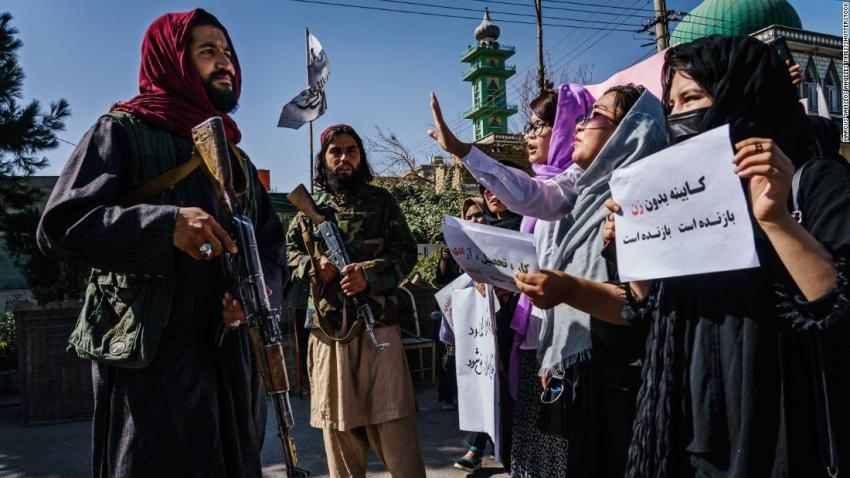 """Taliban fighters try to stop the advance of <a href=""""http://www.cnn.com/2021/09/08/asia/afghanistan-women-taliban-government-intl/index.html"""" target=""""_blank"""">female protesters</a> marching through Kabul, Afghanistan, on Wednesday, September 8. It was a day after the Taliban announced an all-male interim government with no representation for women or ethnic minority groups."""