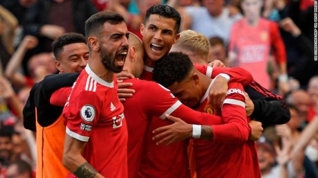 Ronaldo celebrates with teammates after scoring.