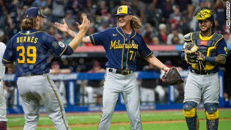 Brewers starting pitcher Corbin Burnes (39) greets relief pitcher Josh Hader as Omar Narvaez watches at the end of a baseball game against the Cleveland Indians on Saturday.