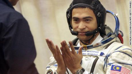Sheikh Muszaphar Shukor, Malaysia's first astronaut, shown taking part in a farewell ceremony at the Baikonur cosmodrome, in Kazakhstan, on October 10, 2007 before lifting off for the International Space Station with Russian cosmonaut Yury Malenchenko and American Peggy Whitson.