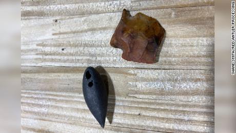 "A plummet, left, and a projectile point of an ""atlatl dart point"" were found inside an alligator on September 2."