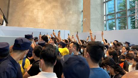 People gathering to demand repayment of loans and financial products at Evergrande's headquarters in Shenzhen on Monday.