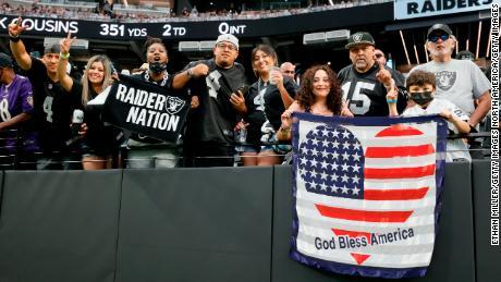 Fans cheering on the Raiders at Allegiant Stadium.
