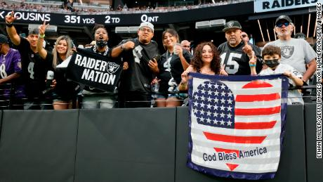 Fans cheer on the Raiders at Allegiant Stadium.