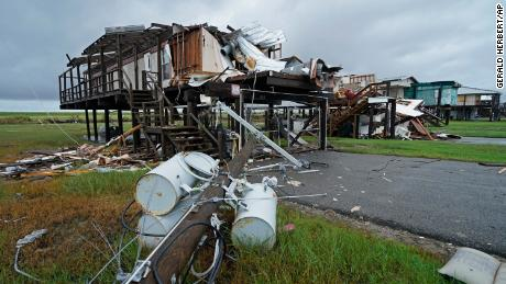 Storm clouds from approaching Tropical Storm Nicholas are seen behind homes destroyed by Hurricane Ida, in Pointe-aux-Chenes, Louisiana.