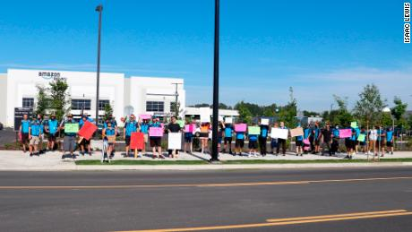 Drivers for Amazon DSPs protest outside a Amazon delivery station in Portland, Oregon this June.