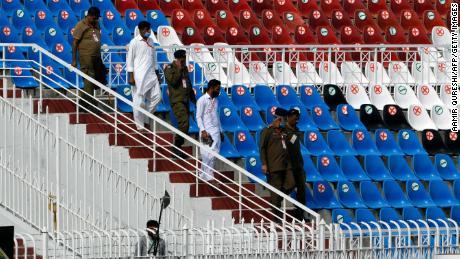 Police walk on the stands of the empty Rawalpindi Cricket Stadium in Rawalpindi on September 17.
