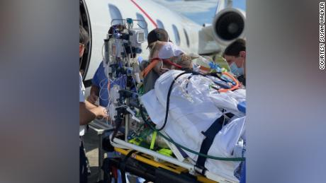 Intubated and sedated, Robby Walker is put on a flight from Florida to St. Francis Hospital in Connecticut.