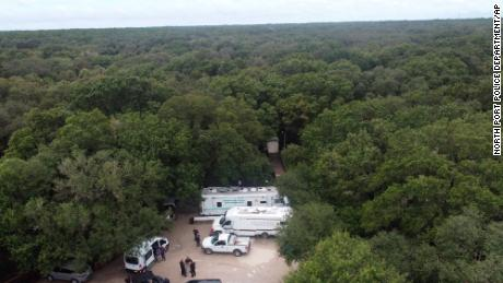 In this photo provided by the North Port Police Department, law enforcement officers search the Carlton Reserve in the Sarasota area of Florida on Saturday for Brian Laundry.