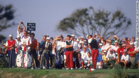 Seve Ballesteros tees off on the fourth hole watched by European team partner Jose Maria Olazabal and US pairing Paul Azinger and Chip Beck.