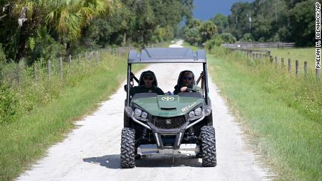 Florida Fish and Wildlife Commission officers ride up a private road near the entrance of the Carlton Reserve during a search for Brian Laundrie on Tuesday, September 21.