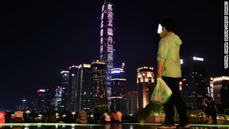 Shenzhen's tallest skyscraper, the Ping An Finance Center, is lit up with a message welcoming Meng Wanzhou's home.