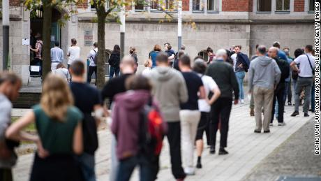 Long lines form in front of a polling station at a school in Friedrichshain.