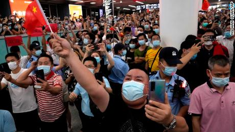 Supporters of Huawei CFO Meng Wanzhou gather at an international airport in Shenzhen Bao in southern China to welcome his return.